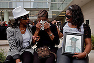 """The family  of Janecia Peters console each other outside the press conference.<br /> LAPD and city officials hold a press conference to announce the capture of the """"Grim Sleeper"""" serial murder suspect, Lonnie David Franklin jr.<br /> Franklin will be charged with 10 counts of murder, and one count of attempted later today."""
