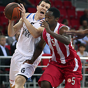 Anadolu Efes's Vlado ILIEVSKI (L) and Olympiacos's Kalin LUCAS (R) during their Two Nations Cup basketball match Anadolu Efes between Olympiacos at Abdi Ipekci Arena in Istanbul Turkey on Sunday 02 October 2011. Photo by TURKPIX