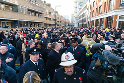 © Licensed to London News Pictures. 23/12/2019. London, UK. Crowds of members and family of the London Fire Brigade gathered to greet London Fire Commissioner (LFC), Dany Cotton on her final day in office. Hundreds of firefighters lined Union Street in London today to provide a Guard of Honour on the final day in office for London Fire Commissioner, Danny Cotton. Photo credit: Vickie Flores/LNP