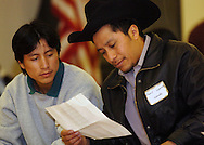 11/11/06 Omaha, NE Noe Diego (left) and Jose Juarez sing a song at a dinner at the Our Lady of Guadalupe social hall Saturday evening..(Chris Machian/Prairie Pixel Group)..