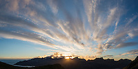 Sun setting behind mountains of Flakstadøy from Skottind, Vestvågøya, Lofoten islands, Norway