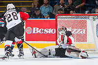 KELOWNA, CANADA - SEPTEMBER 28: Ty Edmonds #35 of Prince George Cougars makes a save against the Kelowna Rockets on September 28, 2016 at Prospera Place in Kelowna, British Columbia, Canada.  (Photo by Marissa Baecker/Shoot the Breeze)  *** Local Caption *** Ty Edmonds;