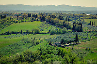 SAN GIMIGNANO, ITALY - CIRCA MAY 2015:  Landscape and vineyards over the hills near San Gimignano in Tuscany