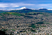ECUADOR, QUITO, SKYLINE view of Quito with Cotopaxi volcano