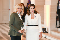 French President's wife Brigitte Macron welcomes Greek Prime Minister's partner Betty Batziana as they take part in a spousal event at the Chateau de Versailles in Versailles, near Paris, on November 11, 2018 as part of commemorations marking the 100th anniversary of the 11 November 1918 armistice, ending World War I. Photo By Laurent Zabulon/ABACAPRESS.COM
