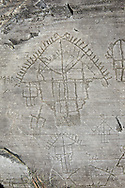 Petroglyph, rock carving, depicting houses built on poles . Carved by the ancient Camunni people in the iron age between 1000-1600 BC. Rock no 24,  Foppi di Nadro, Riserva Naturale Incisioni Rupestri di Ceto, Cimbergo e Paspardo, Capo di Ponti, Valcamonica (Val Camonica), Lombardy plain, Italy .<br /> <br /> Visit our PREHISTORY PHOTO COLLECTIONS for more   photos  to download or buy as prints https://funkystock.photoshelter.com/gallery-collection/Prehistoric-Neolithic-Sites-Art-Artefacts-Pictures-Photos/C0000tfxw63zrUT4<br /> If you prefer to buy from our ALAMY PHOTO LIBRARY  Collection visit : https://www.alamy.com/portfolio/paul-williams-funkystock/valcamonica-rock-art.html