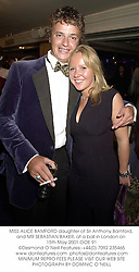 MISS ALICE BAMFORD daughter of Sir Anthony Bamford, and MR SEBASTIAN BAKER, at a ball in London on 15th May 2001.OOE 91