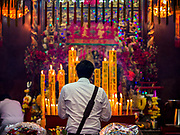 20 OCTOBER 2017 - BANGKOK, THAILAND: People pray in shrines on the first day of the Vegetarian Festival, what Thais call the Taoist Nine Emperor Gods Festival, in the Chinatown neighborhood of Bangkok, Thailand. It is a nine-day Taoist celebration beginning on the eve of 9th lunar month of the Chinese calendar. For nine days people participating in the festival wear only white and don't eat meat, poultry, seafood, and dairy products. The vegetarian festival is celebrated throughout Thailand, but especially in Phuket and Bangkok, cities with large ethnic Chinese communities.       PHOTO BY JACK KURTZ