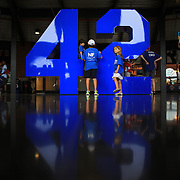 Young baseball fans visit the iconic Jackie Robinson number forty-two in the Jackie Robinson Rotunda at Citi Field Stadium before the New York Mets V Washington Nationals Baseball game at Citi Field, Queens, New York. USA. 28th June 2013. Photo Tim Clayton