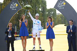 France's Pierre-Roger Latour celebrates his overall best young rider white jersey on the podium after the 21st and last stage of the 105th edition of the Tour de France cycling race between Houilles and Paris Champs-Elysees, in Paris, France, on July 29, 2018. Photo by Eliot Blondet/ABACAPRESS.COM