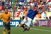 Photo: AF Wrofoto/Sportsbeat Images.<br />Italy v Australia. 2nd Round, FIFA World Cup 2006. 26/06/2006.<br />Marco Materazzi of Italy dives emphatically to reach the ball, as Australia's Mark Viduka (L) looks on.