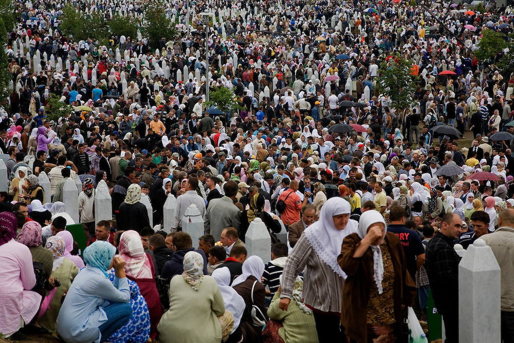 Families of Srebrenica victims gather at the Potocari memorial to bury the remains of their loved ones. Overview of Potocari crowds.