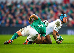 England's Jack Nowell is tackled by Ireland's Rory Best - Photo mandatory by-line: Ken Sutton/JMP - Mobile: 07966 386802 - 01/03/2015 - SPORT - Rugby - Dublin - Aviva Stadium - Ireland v England - Six Nations