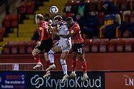 Shrewsbury Town Midfielder Shaun Whalley is sandwiched by Lincoln City Defender Timothy Eyoma (22) & Lincoln City Midfielder Tayo Edun(7) during the EFL Sky Bet League 1 match between Lincoln City and Shrewsbury Town at Sincil Bank, Lincoln, United Kingdom on 15 December 2020.