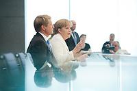 21 JUL 2010, BERLIN/GERMANY:<br /> Ulrich Wilhelm (L), Regierungssprecher, Angela Merkel (R), CDU, Bundeskanzlerin, Pressekonferenz vor der Sommerpause, Bundespressekonferenz<br /> IMAGE: 20100721-02-016<br /> KEYWORDS: Kamera, Camera