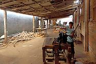 Boy in wood work shop in Pinar del Rio, Cuba.