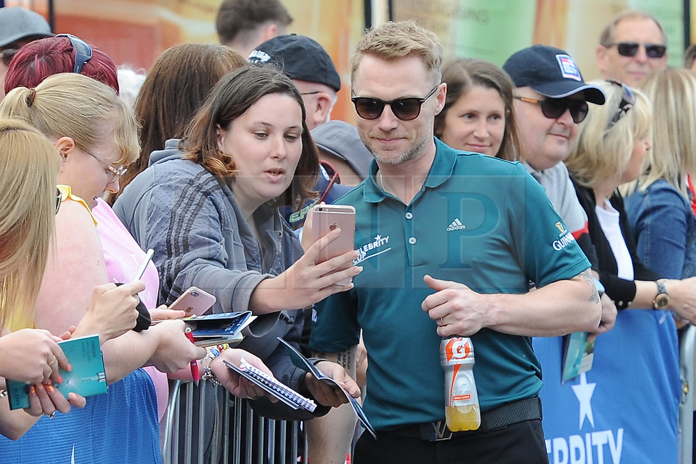 © Licensed to London News Pictures. 01/07/2017. London, UK, Boyzone band member Ronan Keating takes time for a selfie with a supporter during The 2017 Celebrity Cup golf tournament at the Celtic Manor Resort, Newport, South Wales. Photo credit: Jeff Thomas/LNP