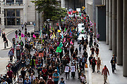 A group of Extinction Rebellion activists march through the streets playing instruments and holding up banners and signs on 27th August, 2021 in London, United Kingdom. The activist group Extinction Rebellion XR are planning actions of disruption for two weeks straight beginning on August 23rd, 2021 in an effort to bring awareness and priority to the global climate emergency in advance of the COP 26 Summit which will be held in Glasgow later this year.