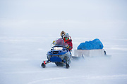 Charlotte Crosby TLC Travel show. Charlotte on the back of a skidoo being driven by Sarah on teh Iqaluit Ice Trip