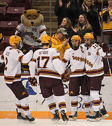 November 17, 2017 - Minneapolis, MN, USA - Teammates celebrated with Minnesota forward Brent Gates Jr. (10) after Novak scored a goal in the first period against Harvard on Friday, Nov. 17, 2017, at the 3M Arena at Mariucci in Minneapolis. (Credit Image: © Aaron Lavinsky/TNS via ZUMA Wire)