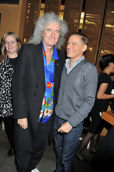 Left to right, BRIAN MAY and BRYAN ADAMS at the Pig Business Fundraiser, Sake No Hana, St.James's, London on 26th September 2012.