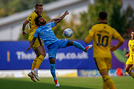 Coventry City defender Junior Brown (12) battles with Oxford United defender Cameron Norman (2)  during the EFL Sky Bet League 1 match between Oxford United and Coventry City at the Kassam Stadium, Oxford, England on 9 September 2018.