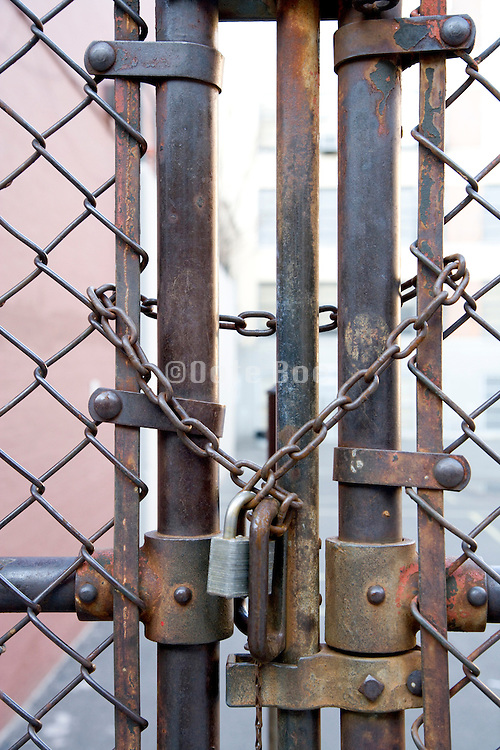 close up of a padlocked gate in metal fence