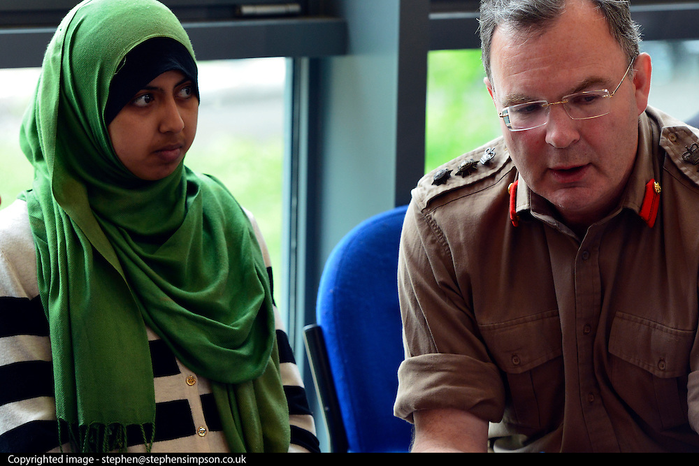 © Licensed to London News Pictures. 24/05/2013. London, UK. Hugh Bodington Chief of Staff for British Army at Headquarters London District & Headquarters Household Division talks to a member of the community. Nick Clegg, Liberal Democrat MP and Deputy Prime Minister, attends a multi faith gathering with the local multi faith community at the Hugh Cubitt Peabody Centre in Islington London today 24th May 2013. After meeting privately with political and faith leaders he and they made speeches in response to the attack and death of Drummer Lee Rigby in Woolwich, calling for the community to unite against the attack. Photo credit : Stephen Simpson/LNP