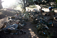 Marines, including Cpl. David Jarvis, bottom left, relax before the days' live-fire exercises for the 2nd Battalion, 5th Marine Regiment at Camp Pendleton.