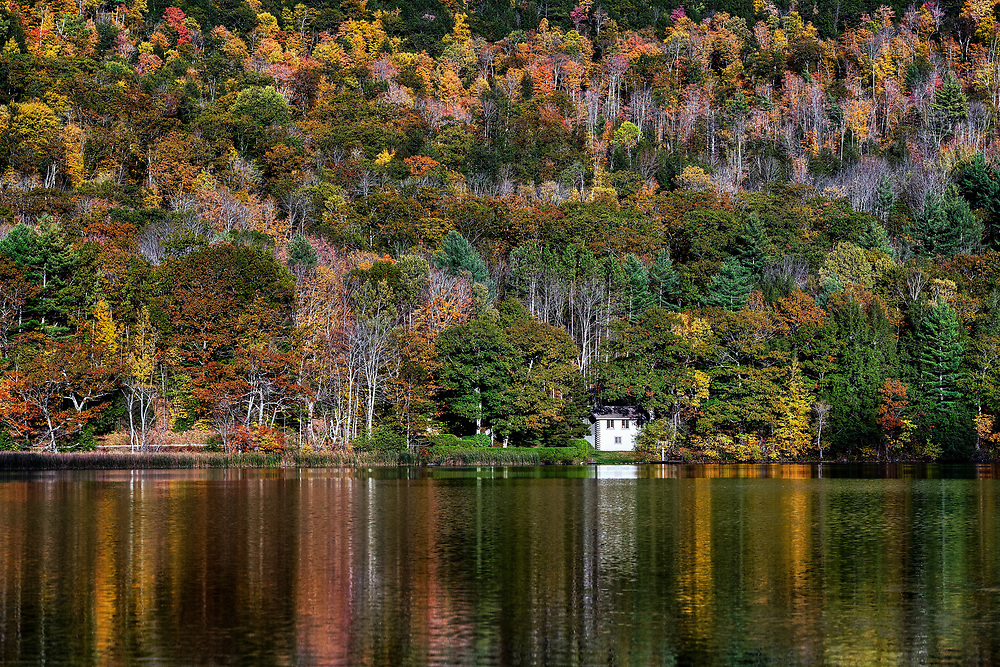 Seclude house on Echo Lake with autumn foliage, Vermont, USA