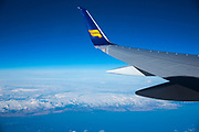 In flight Icelandair Airline Boeing 757 - 200 airplane flying in blue skies over Iceland