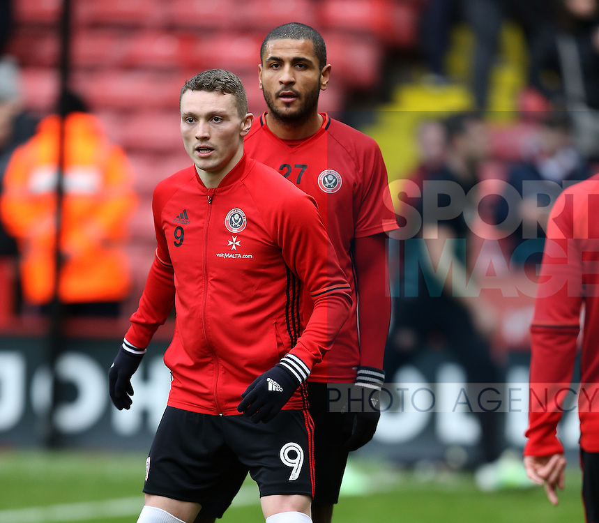 Caolan Lavery of Sheffield Utd and Leon Clarke of Sheffield Utd during the English League One match at Bramall Lane Stadium, Sheffield. Picture date: December 31st, 2016. Pic Simon Bellis/Sportimage