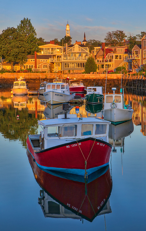 Massachusetts working  harbor scenery of lobster fishing boats in the sunrise hours at Rockport Harbor on Cape Ann, Massachusetts.<br /> <br /> Rockport Harbor photography images are available as museum quality photo, canvas, acrylic, wood or metal prints. Wall art prints may be framed and matted to the individual liking and New England interior design projects decoration needs.<br /> <br /> Good light and happy photo making!<br /> <br /> My best,<br /> <br /> Juergen