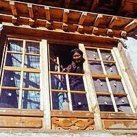 A Sherpani woman looks out of her house in Namche Bazar in the Khumbu region of Nepal. 1979