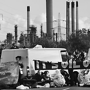 The Crude Awakening blockade on the road to the Coryton oil refinery. 12 women locked themselves under 2 white vans in the morning and was later joined by fellow activists who out ran the police  across fields. ..Crude Oil Awakening is a coalition of climate change activist groups. On Saturday Oct 16 they shut the only entrance to Coryton oil refinery in Essex, UK with the aim of highlighting the issues of climate change and the burning of fossil fuels. The blockade meant that a great number of trucks with oil were not able to leave the refinary during the day of action.