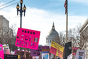 """San Francisco, USA. 19th January, 2019. The Women's March San Francisco sets out from  Civic Center Plaza in front of City Hall. Assorted signs above the crowd include: """"Proud Jewish Feminist"""" and """"We are Intersectional Feminists."""" Credit: Shelly Rivoli/Alamy Live News"""