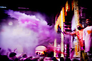 Holi festival, India, on wednesday, mar. 9, 2009. Inside the Banket Bihari temple in Vrindavan. From the stage powder is thromn over the audience.