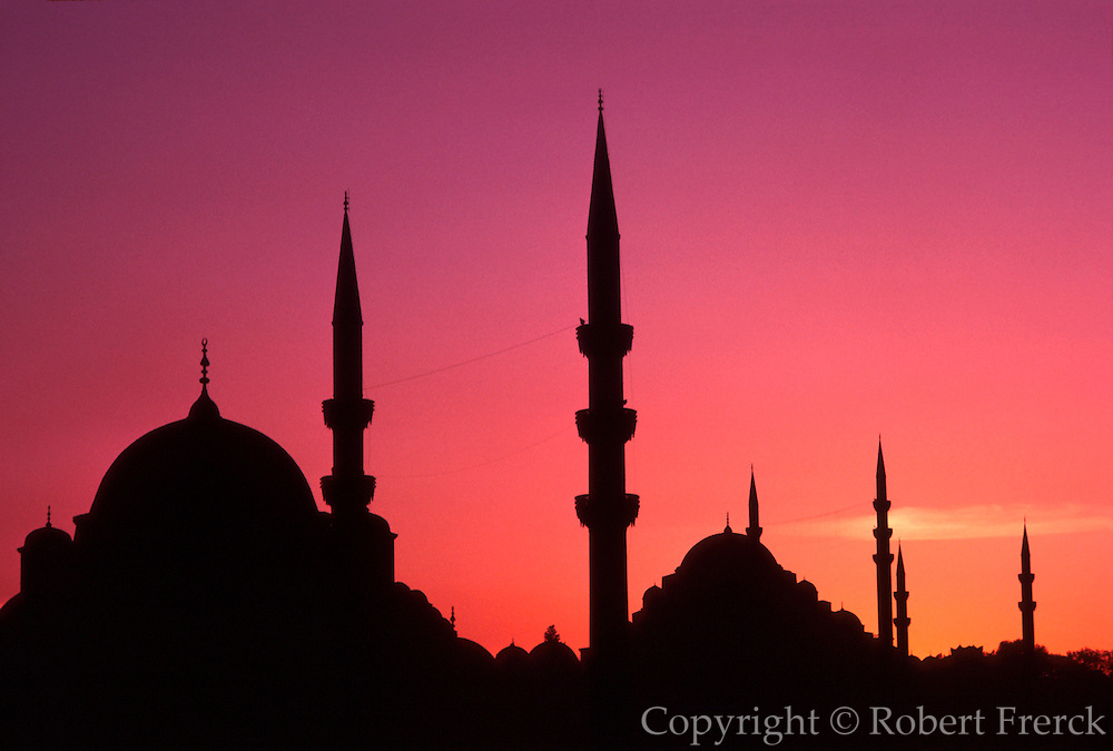 TURKEY, ISTANBUL, SKYLINE domes and minarets at dusk, of the Yeni Mosque (foreground) and the S�leymaniye Mosque (background)