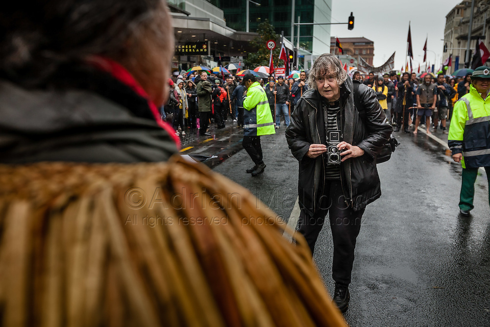 Acclaimed social documentary photographer Ans Westra with her Rollei TLR camera.<br /> Members and supporters of Auckland Iwi march toward central Auckland in a Hikoi to protest the New Zealand government's plan to create an Auckland Supercity without Maori consultation and representation.<br /> 25th May 2009