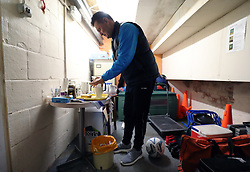 Sutton United manager Paul Doswell makes himself a cup of tea and a slice of toast ahead of a training session at Gander Green Lane, London.
