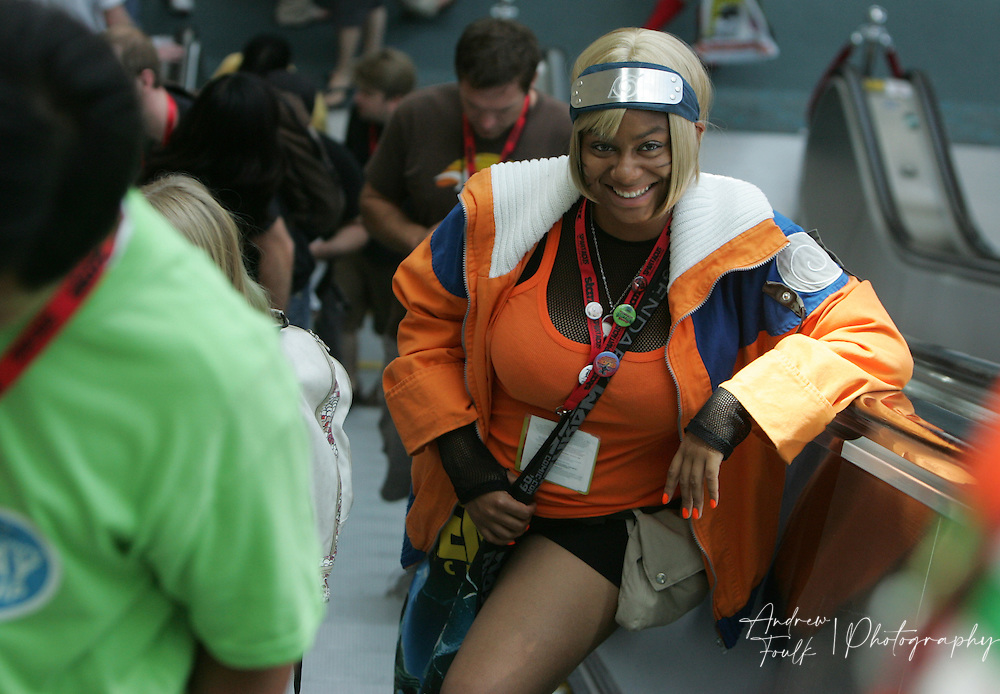 Andrew Foulk/ Zuma Press.July 23, 2009, San Diego, California, USA. Comic Con. A costumed girl makes her way up one of the escalators at the San Diego Convention Center, during day one of the 40th annual San Diego International Comic Con.