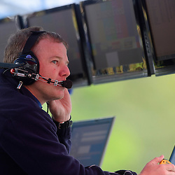 Stevenson Motorsports team manager Mike Johnson in the pit stand during qualifying for the Rolex Grand-Am Sports Car Series Championship weekend race at Lime Rock Park in Lakeville, Conn.