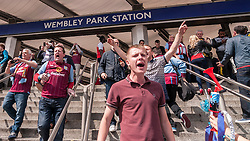 © Licensed to London News Pictures. 30/05/2015. London, UK. Aston Villa supporters exiting the tube station, as fans gather at Wembley Stadium for the FA Cup Final 2015, between Arsenal and Aston Villa. Photo credit : Stephen Chung/LNP