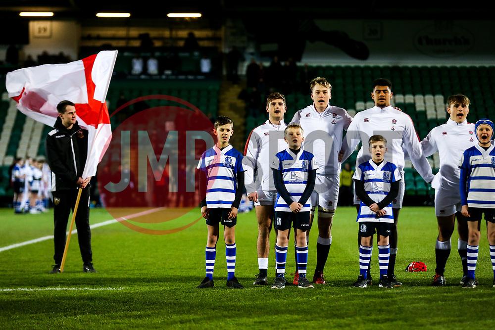 Sam Maunder, Richard Capstick adn Rusiate Tuima as England U20 line up for the national anthem - Rogan/JMP - 21/02/2020 - Franklin's Gardens - Northampton, England - England U20 v Ireland U20 - Under 20 Six Nations.
