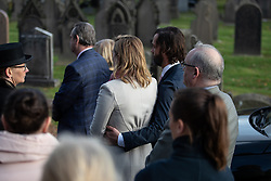 © Licensed to London News Pictures . 30/10/2018. Accrington , UK . The actress KATE WINSLET enters the crematorium with her husband EDWARD SMITH (aka NED ROCKNROLL ) holding her around the waist , at the start of the service . The funeral of Gemma Nuttall at Accrington Crematorium . Gemma died of cancer despite initially seeing off the disease after radical immunotherapy treatment in Germany , paid for with the fundraising support of actress Kate Winslet , who read of Gemma's plight on a crowdfunding website shortly after she lost her own mother to cancer . Permission to photograph given by Gemma's mother , Helen Sproates . Photo credit : Joel Goodman/LNP