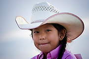 08 SEPTEMBER 2007 -- FT. DEFIANCE, AZ: A child waits to participate in the Grand Entry at the All Women Rodeo in the Dahozy Stampede Rodeo Arena in Ft. Defiance, AZ, on the Navajo Indian Reservation. It was the first all women's rodeo on the Navajo Indian Reservation.  Photo by Jack Kurtz/ZUMA Press
