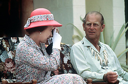 File photo dated 26/10/1982 of Queen Elizabeth taking a photograph when she and the Duke of Edinburgh visited the South Sea Islands of Tuvalu. The Royal couple will celebrate their platinum wedding anniversary on November 20.
