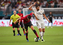 July 31, 2018 - Miami Gardens, Florida, USA - Manchester United F.C. midfielder Ander Herrera (21) fights for the ball with Real Madrid C.F. forward Karim Mostafa Benzema (9) during an International Champions Cup match between Real Madrid C.F. and Manchester United F.C. at the Hard Rock Stadium in Miami Gardens, Florida. Manchester United F.C. won the game 2-1. (Credit Image: © Mario Houben via ZUMA Wire)