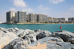 Modern residential apartment buildings at Al Zeina Beach at Al Raha Beach district in Abu Dhabi United Arab Emirates