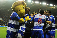 Reading's Adam Le Fondre is swamped by his teammates and club mascot  after he scores his 2nd to make it 2-2.  Barclays Premier league, Reading v Chelsea at the Madejski Stadium in Reading on Wednesday 30th Jan 2013. pic by Andrew Orchard, Andrew Orchard sports photography,